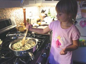Zoe cooking salmon pasta